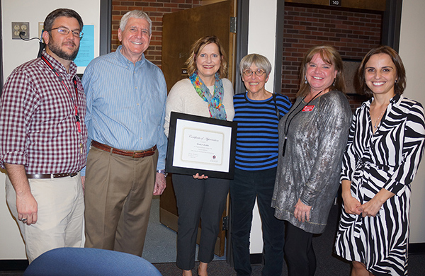faculty honored Doris Schuldt, third from right, during the open house of the Office for Play Therapy Research and Training. Mrs. Schuldt donated her extensive play therapy library to the office, which opened a year ago.